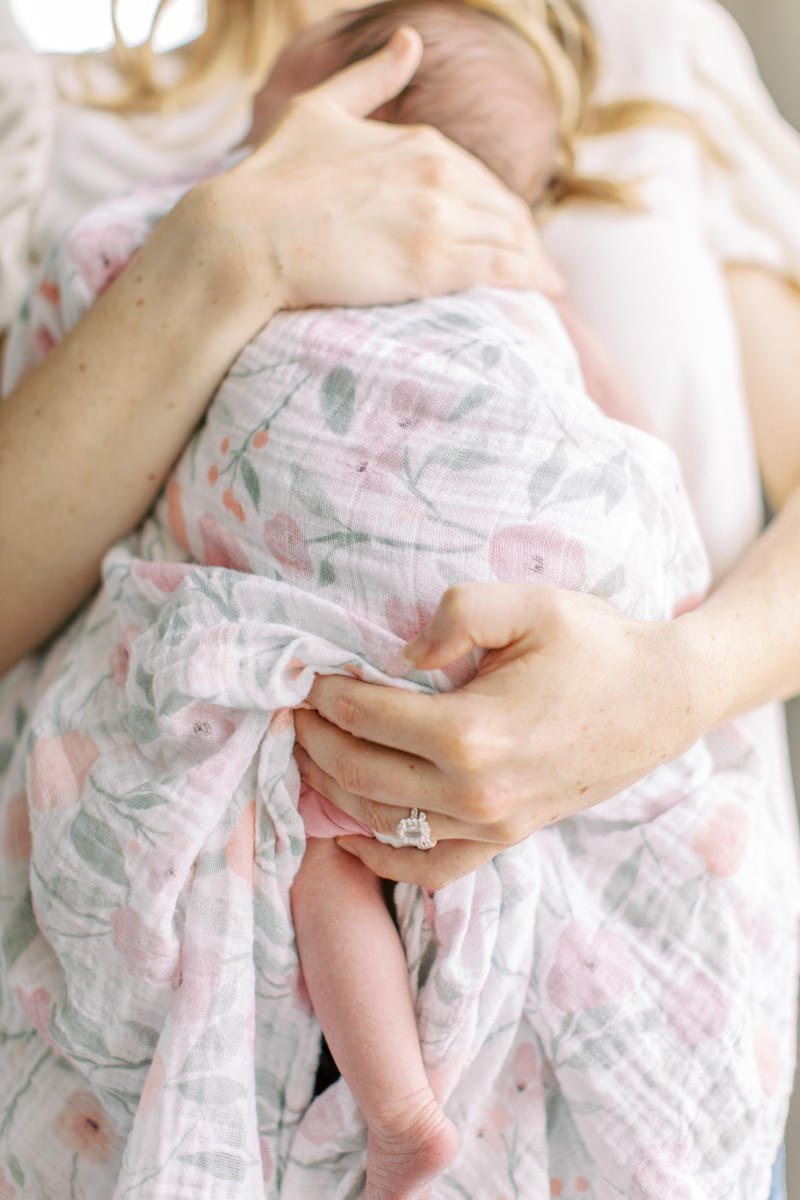 Calgary Newborn Photographer holding baby