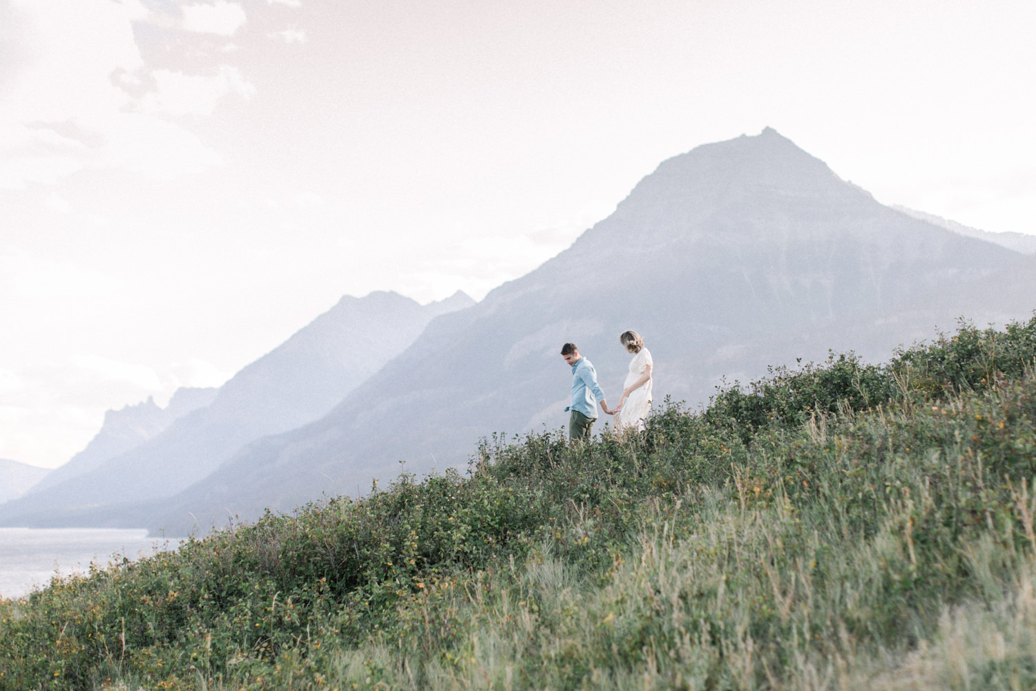 Calgary and Banff Maternity Photography outdoor Waterton summer session walking shot