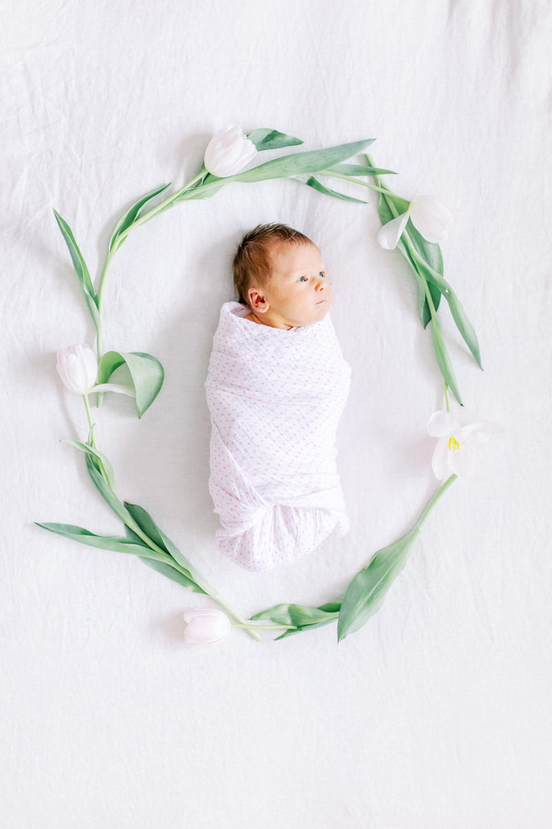 Calgary Newborn Photography in home session newborn with flowers