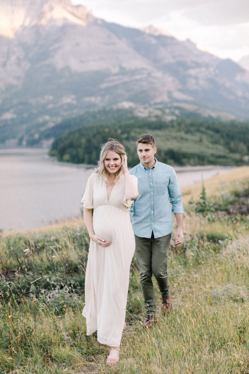 Calgary and Banff Maternity Photography outdoor Waterton summer session walking couple