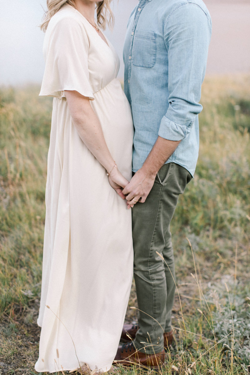 Calgary and Banff Maternity Photography outdoor Waterton summer session holding hands