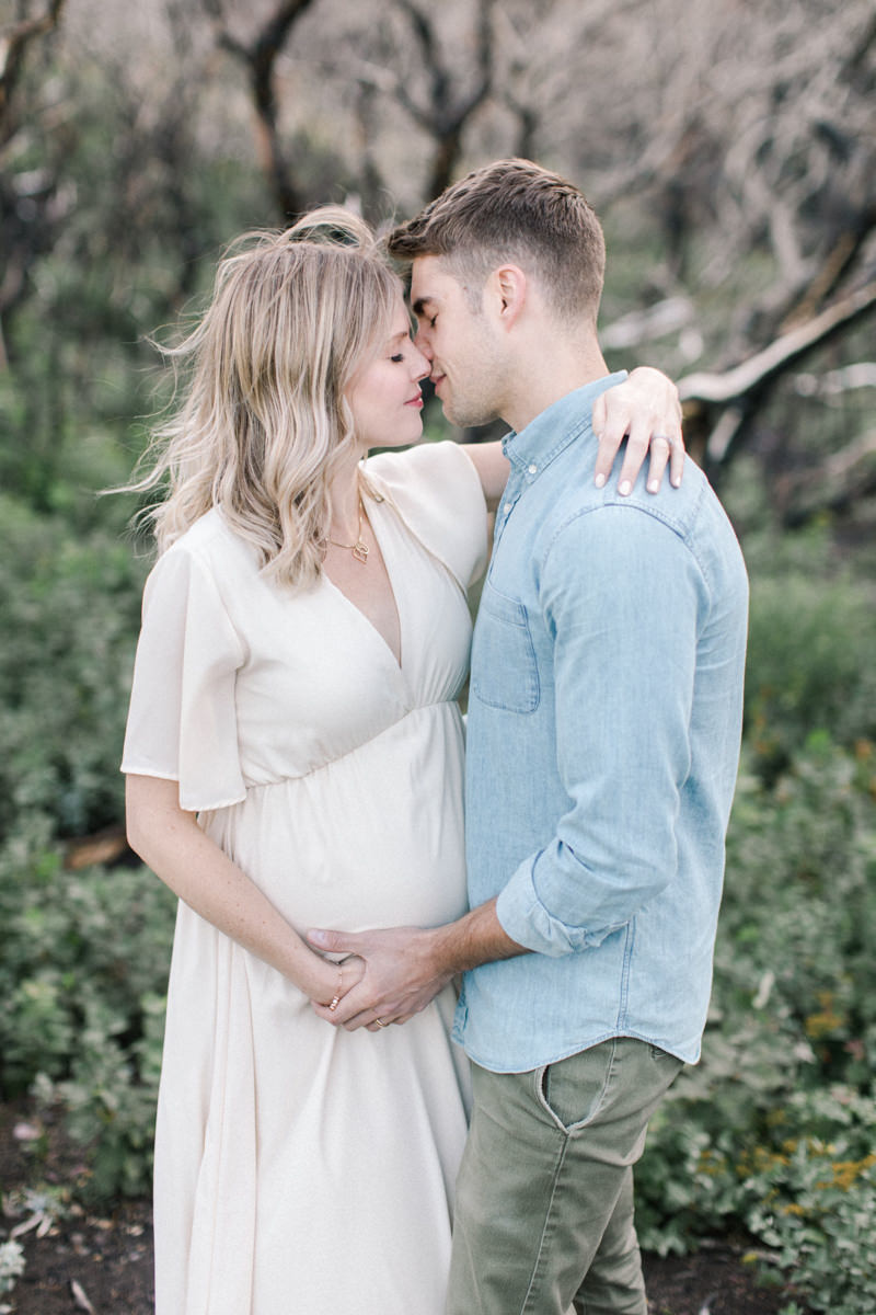 Calgary and Banff Maternity Photography outdoor Waterton summer session couple portrait kissing in trees