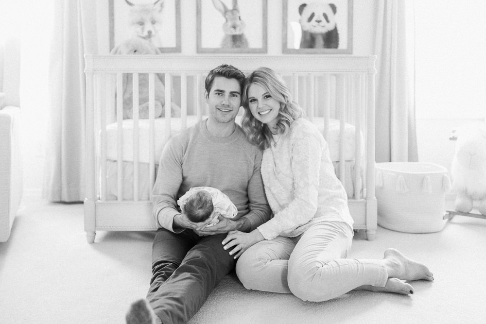 new family with baby in nursery