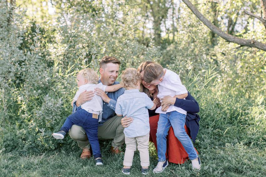 Calgary Family photography fish creek park family hugging
